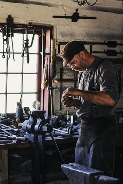 Craftsman surrounded by tools